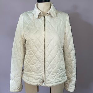 Burberry polyester quilted zip up jacket.